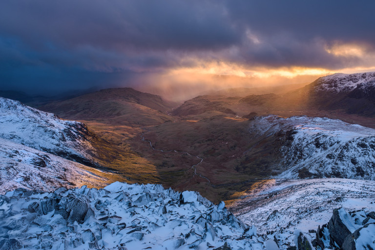 Dramatic sunset on Bow Fell in Winter