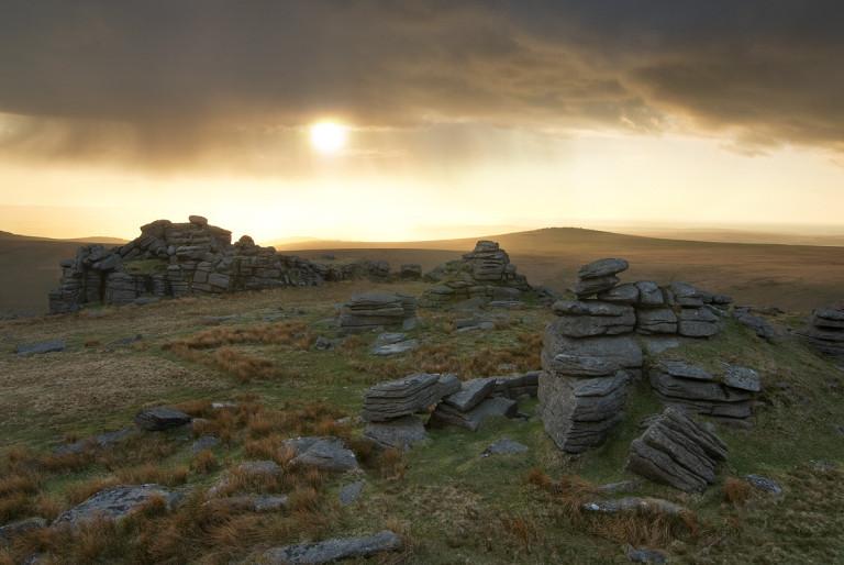 Rain clouds pass over dartmoor at sunset