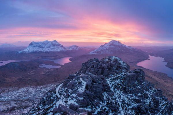 colourful sunrise over scottish mountains