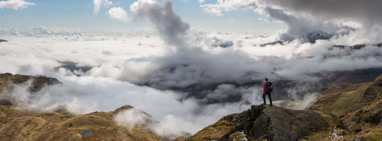 Hiker over lake district cloud inversion