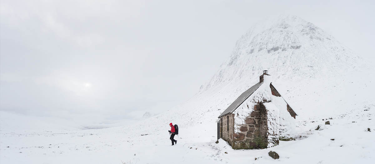 Hiker leaving Corrour bothy