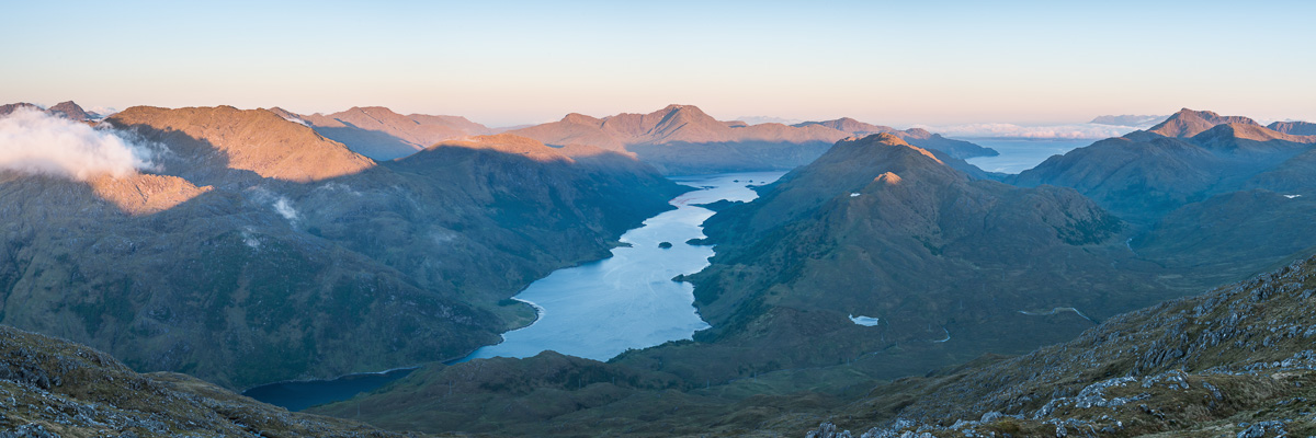 Loch Hourn at sunrise with Ladhar Beinn in the distance