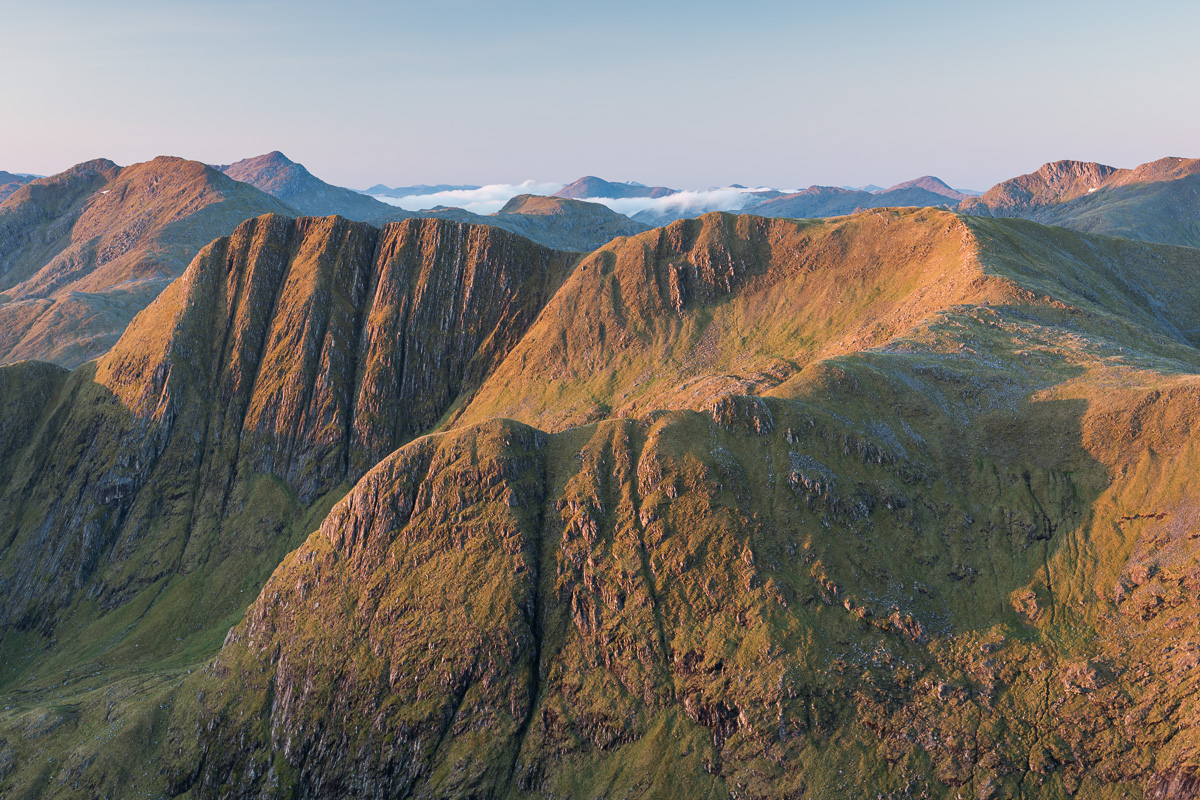 The dramatic face of Bealach Coire Dhorrcail is lit up by the rising sun