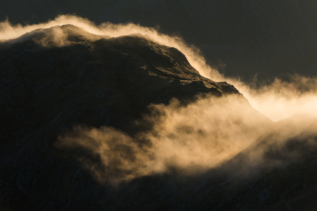 Pathes of mist flow over the ridge of Bhudie Bhienn