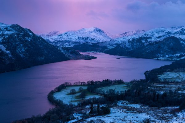 Mountain sunset in water over ullswater