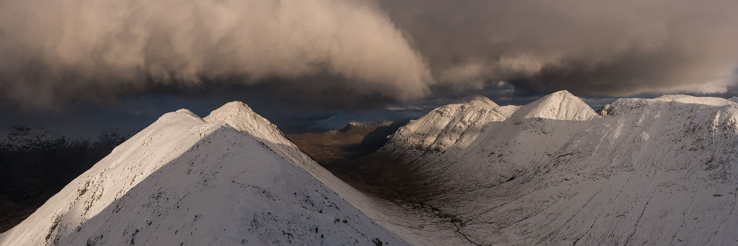 Storm clouds over Scottish mountain in winter