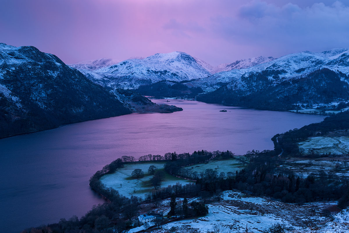 Ullswater reflecting the pink glow of sunset